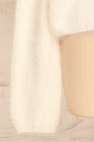 Benavente Cream Fuzzy Knit Turtleneck Sweater | La Petite Garçonne bottom close-up