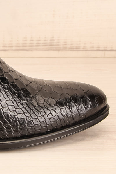 Bobby Snake Black Snakeskin Heeled Ankle Boots side front close-up | La Petite Garçonne
