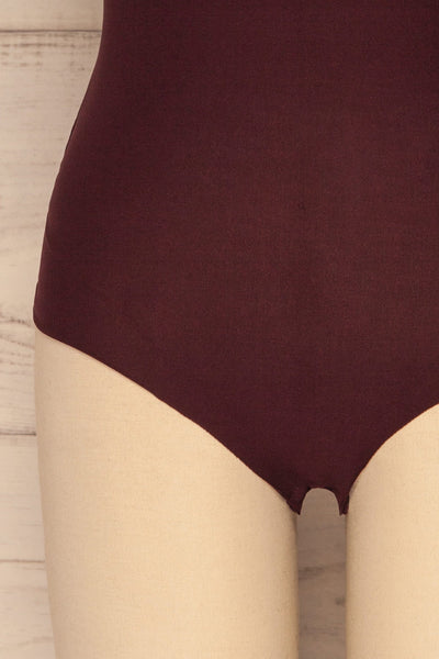 Caitlyn Fig Stretchy Bodysuit | Justaucorps | La Petite Garçonne bottom close-up