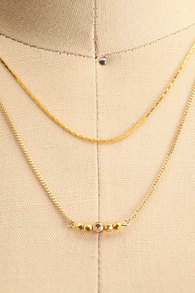 Camilia Sukh Golden Double Chain Pendant Necklace on mannequin close-up | Boutique 1861