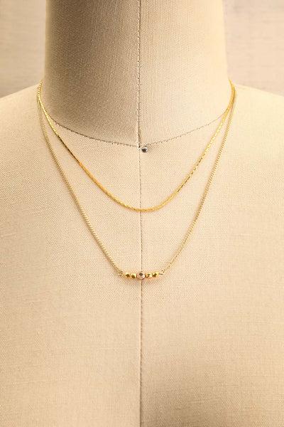 Camilia Sukh Golden Double Chain Pendant Necklace on mannequin | Boutique 1861