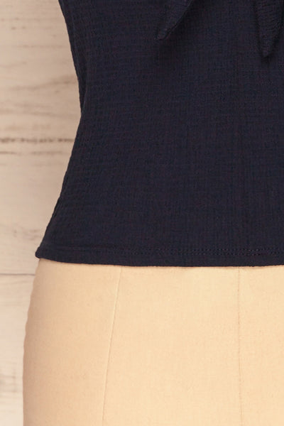 Cardiff Navy Blue V-Neck Knotted Top | La Petite Garçonne bottom close-up