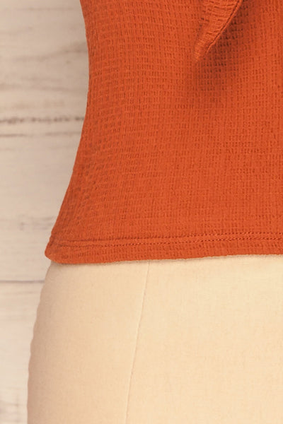 Cardiff Rust Orange V-Neck Knotted Top | La Petite Garçonne bottom close-up