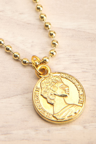 Centum Gold Medallion Pendant Necklace flat lay close-up | La Petite Garçonne