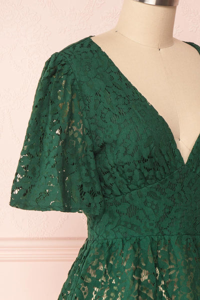 Claatje Green Lace Peplum Top with Plunging Neckline | Boutique 1861 side close-up