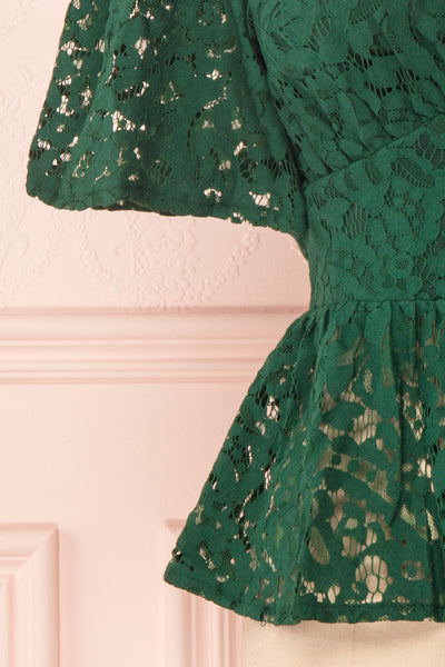 Claatje Green Lace Peplum Top with Plunging Neckline | Boutique 1861 bottom close-up