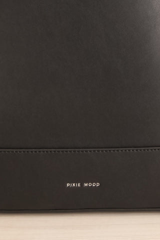 Coran Black Pixie Mood Faux-Leather Backpack logo close-up | La Petite Garçonne