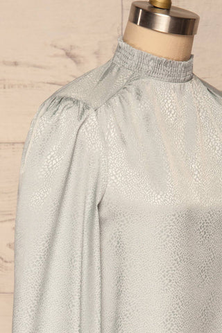 Corenne Pale Blue Satin Blouse | Haut side close up | La Petite Garçonne