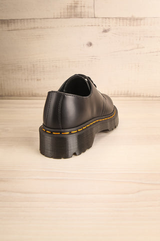Crawley Leather Black Dr. Martens Shoes back view | La Petite Garçonne