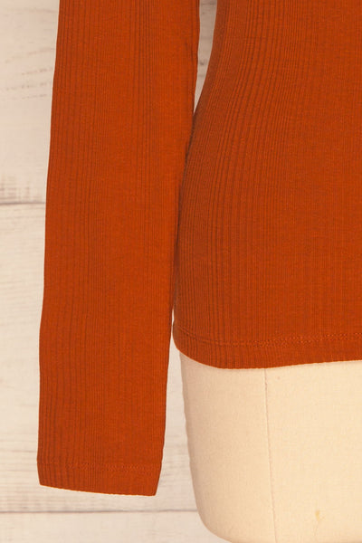 Didima Cinnamon Orange Ribbed Top with Stand Collar | La Petite Garçonne bottom close-up