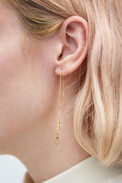 Doris Day Gold Chain & Charm Pendant Earrings | La Petite Garçonne model