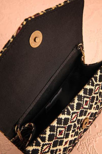 Forro - Black and beige embroidered clutch bag