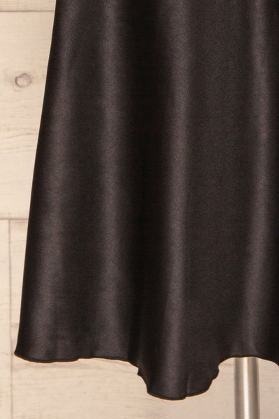 Glyfada Black Silky Midi Skirt bottom close up | La Petite Garçonne