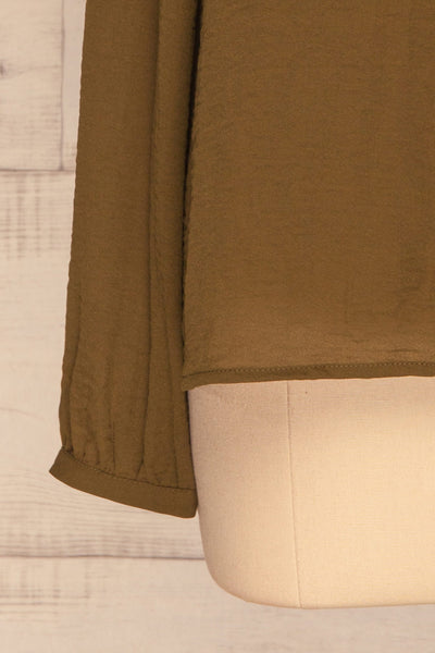 Gretel Olive Blouse | Chemisier | La Petite Garçonne bottom close-up