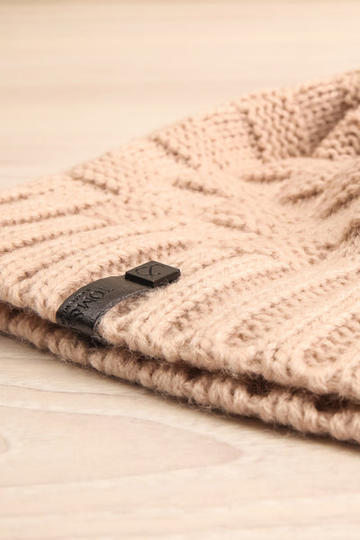 Honokaa Beige Knit Tuque with Faux-Fur Pompom flat close-up | La Petite Garçonne
