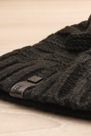 Honokaa Noir Black Tuque with Faux-Fur Pompom flat close-up | La Petite Garçonne
