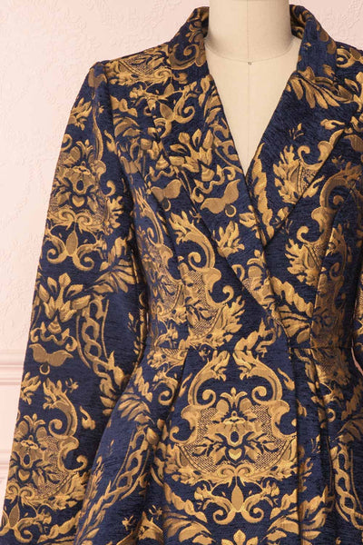 Hyleoroi Navy & Gold Jacquard Pleated Princess Coat | Boutique 1861 front close-up
