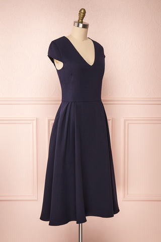 Iktomi Navy A-Line Midi Dress w/ V Neck side view | Boutique 1861