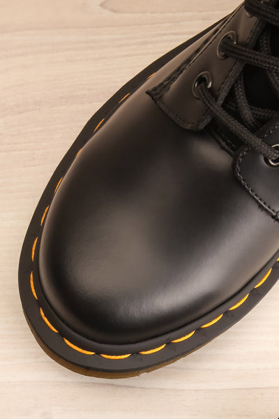 Kirkbride Leather Black Dr. Martens Boots flat lay close-up | La Petite Garçonne
