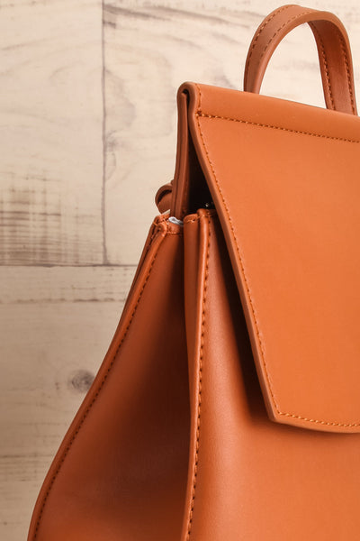 Kyym Cognac Pixie Mood Faux-Leather Backpack side close-up | La Petite Garçonne