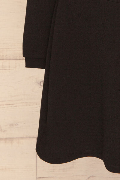 Lydie Noir Black A-Line Dress | Robe | La Petite Garçonne bottom close-up