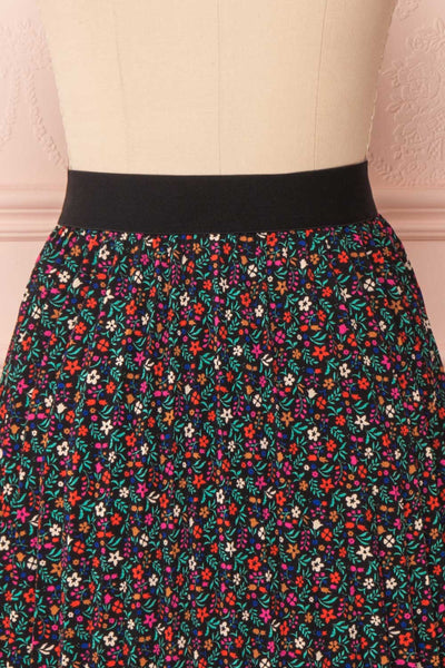 Maura Black & Colourful Floral Pleated Midi Skirt | BACK CLOSE UP | Boutique 1861