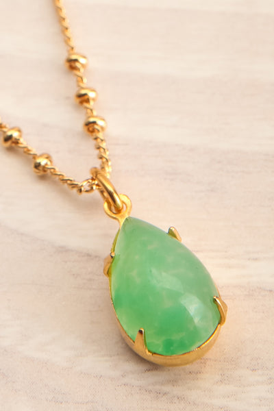 Natalie Dessay Green & Golden Pendant Necklace | La Petite Garçonne flat close-up