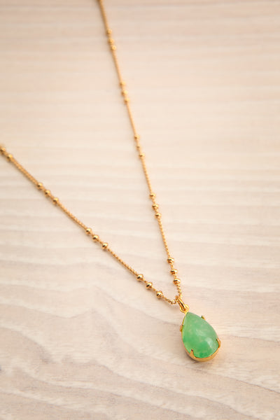 Natalie Dessay Green & Golden Pendant Necklace | La Petite Garçonne flat lay