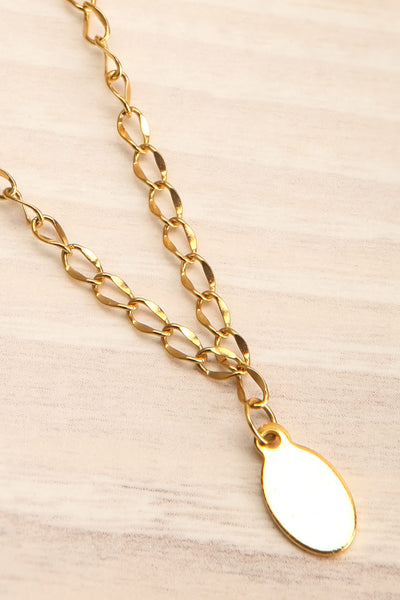 Nika Gold Pendant Necklace | Collier | La Petite Garçonne flat close-up