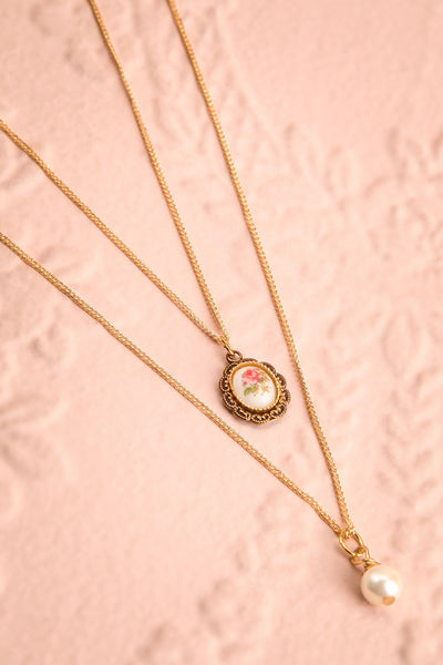Patti Lupone Golden Frame & Pearl Pendant Necklace flat-lay | Boutique 1861