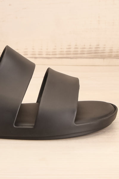 Pichincha Black Slip-On Sandals | La petite garçonne side close-up