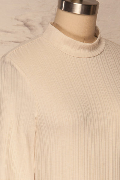 Pieszyce Cream White Mock Neck Top side close up | La petite garçonne