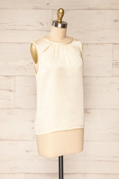 Riccia Cream Sleeveless Pleated Neck Blouse | La petite garçonne side view