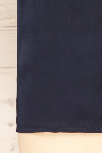 Riccia Navy Sleeveless Pleated Neck Blouse | La petite garçonne bottom close-up