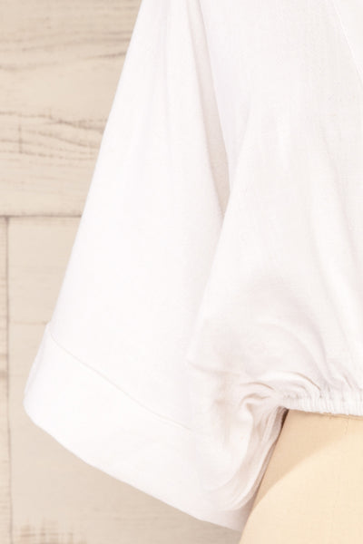 Thebes White Linen Kimono Style Crop Top | La petite garçonne bottom close-up