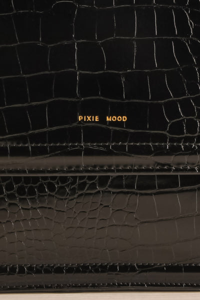 Victoria Black Vegan Textured Crossbody Handbag | La petite garçonne logo close-up