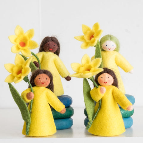 Ambrosius doll holding daffodil (yellow) fair skin