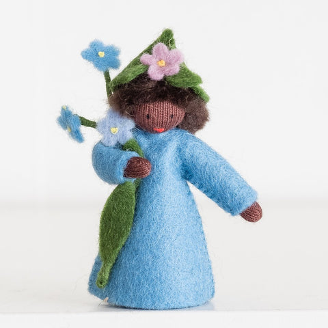 Ambrosius doll holding forget me not (blue) dark skin