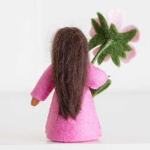 Ambrosius doll holding sweet briar pink flower medium skin