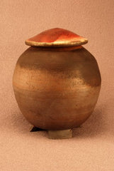 Raku ceramic pet urn-handthrown-dark matte body-red bronze top-handcarved feet