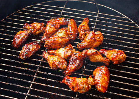 Loren Hill's bbq chicken wings cooking on the smoker.