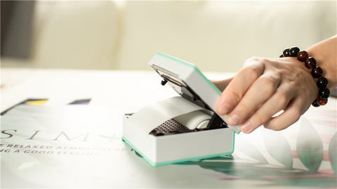 Does the portable thermal printer use ink?