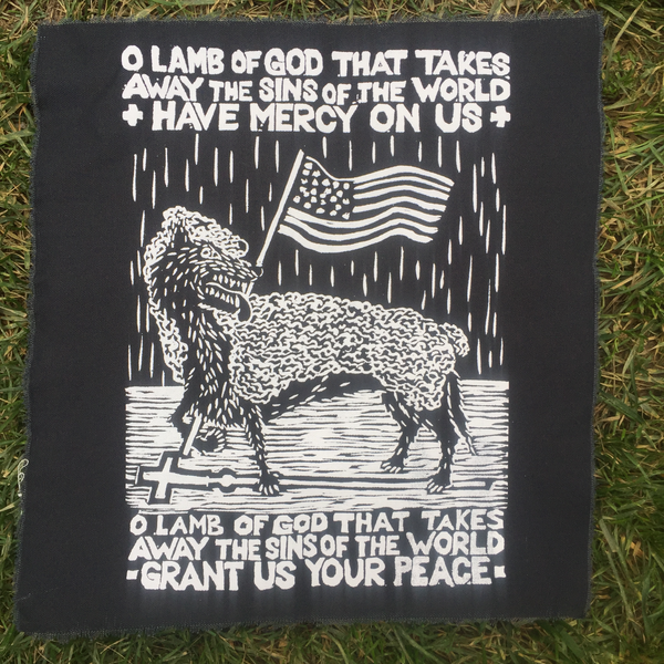black canvas patch with text O LAMB OF GOD THAT TAKES AWAY THE SINS OF THE WORLD HAVE MERCY ON US O LAMB OF GOD THAT TAKES AWAY THE SINS OF THE WORLD GRANT US YOUR PEACE with a drooling wolf draped in the skin of a dead lamb stomping on a cross and holding an American flag in a pose reminiscent of the classic Christian iconography of a lamb holding a flag with a cross.