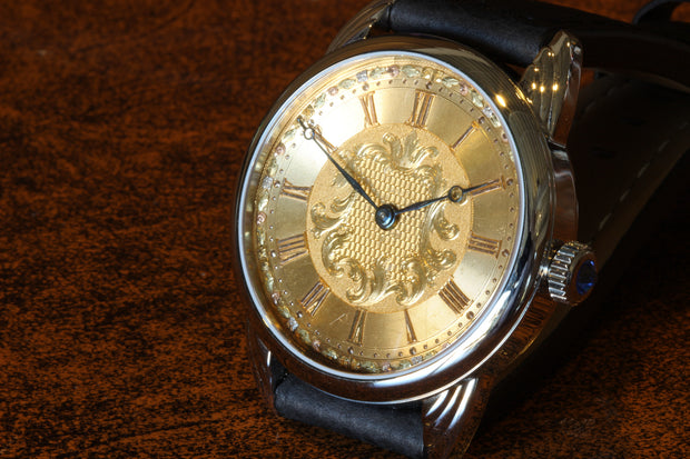RPaige Wrocket Hand engraved gold dial watch