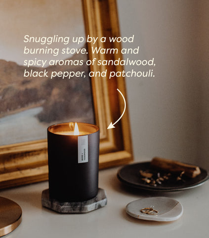 image of musk and teakwood candle on side table