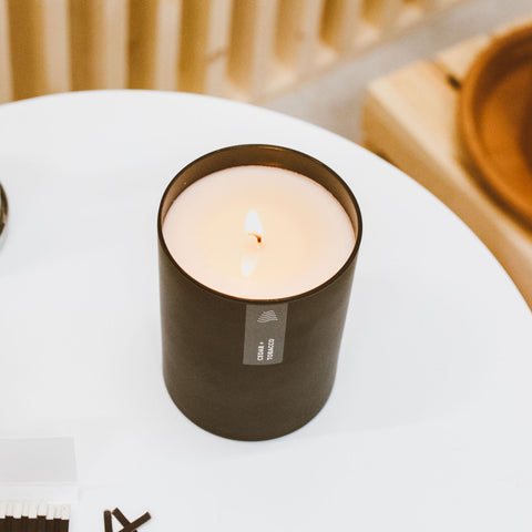 cedar tobacco black tumbler soy candle on table