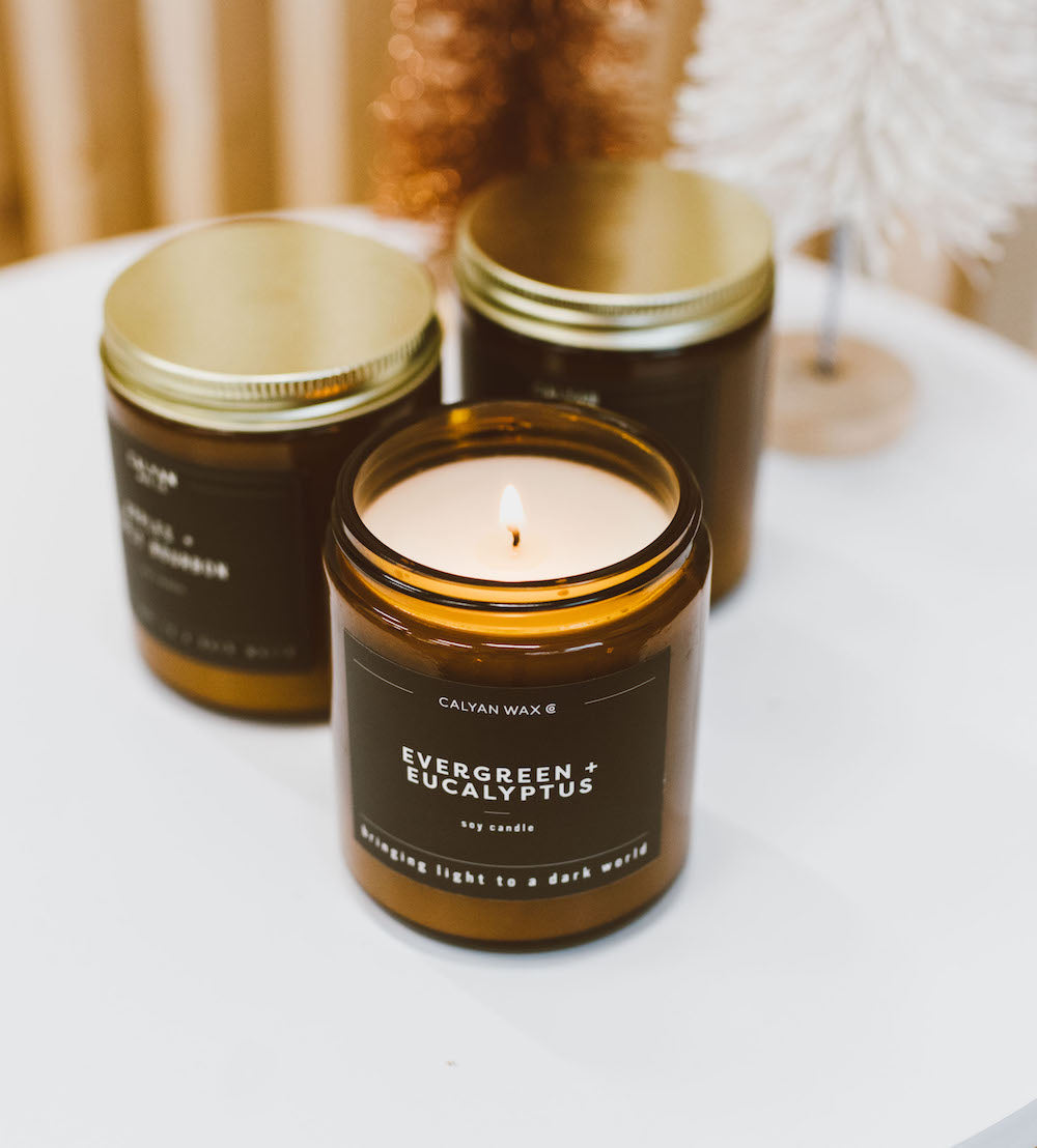 smoky soy candle in an amber jar