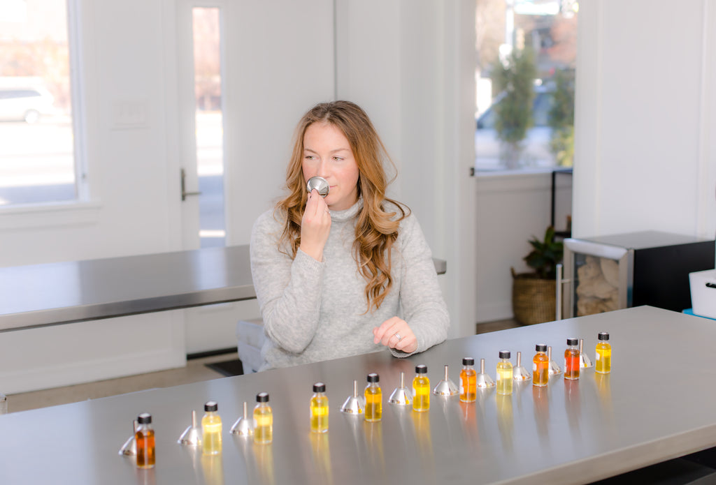 Founder, Elise Wishlow, sniffs the new aromatherapy and perfume collections using a type of perfume cloche.