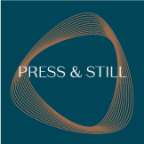 Press & Still logo over copper spiral and deep cerulean background.
