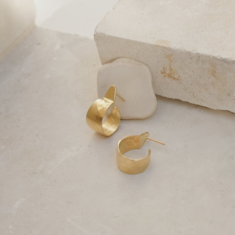 Boulder hoops in recycled brass with gold-plated silver studs.